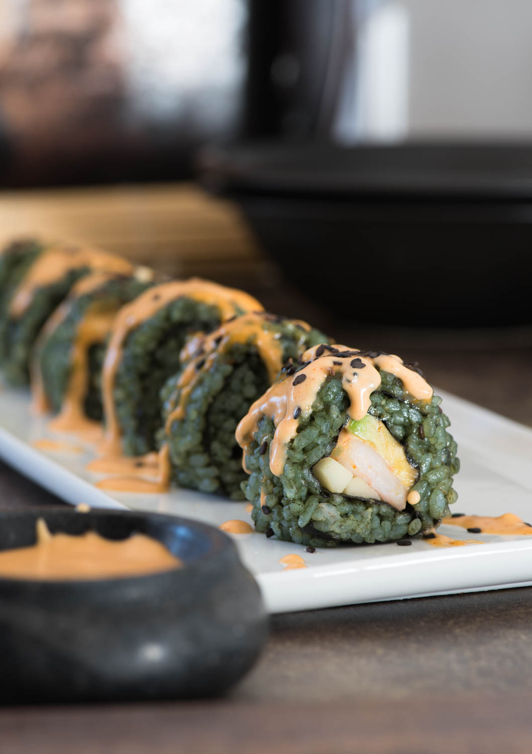 healthy sugar free sushi rolls with shrimp and avocado - naturally colored and topped with spicy mayo sauce