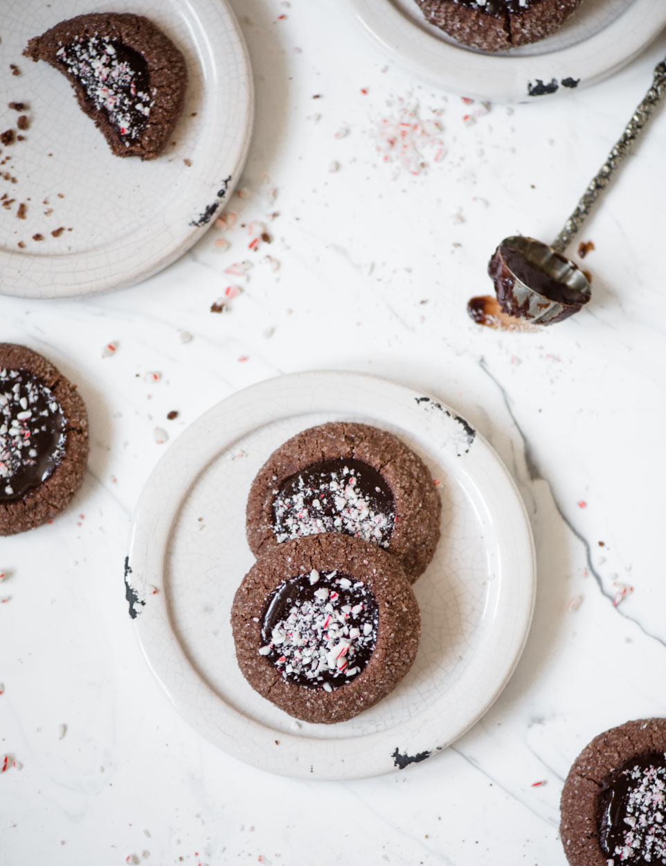 chocolate peppermint thumbprint cookies on white plates